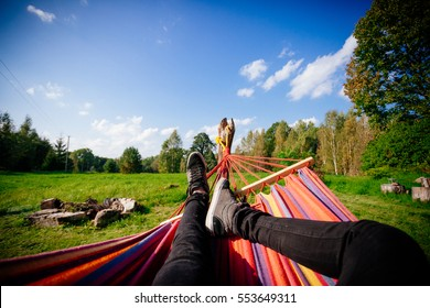 Man in hammock, first person look, warm summer day