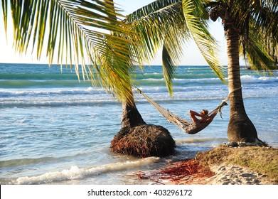 Man in hammock on the beach