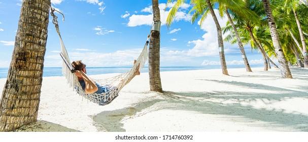 Man in hammock on the beautiful tropical beach. Banner.