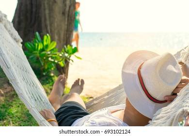 Man hammock sleep on the beach in Thailand.