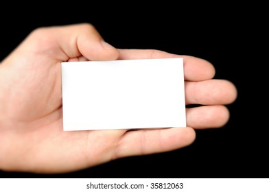 Man Hand And A Card Isolated On Black Background
