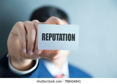 man hand card on reputation text