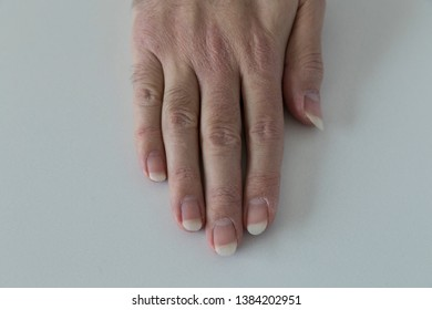 man hand care with cream on the white background.