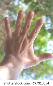 Man hand close up in nature of tropical island of Bali.