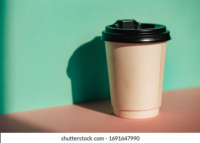 Man hand coffee cup. Coffee time. Hand. Man. Good morning. Background. Drink. Plastic. Cafe.