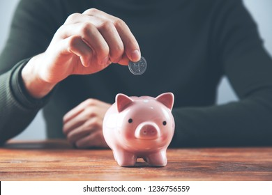 man hand coins with piggy bank