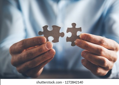 man hand connecting couple puzzle
