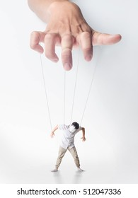 man hand controlling a boy marionette