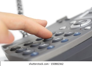 man hand is dialing a phone number with picked up headset