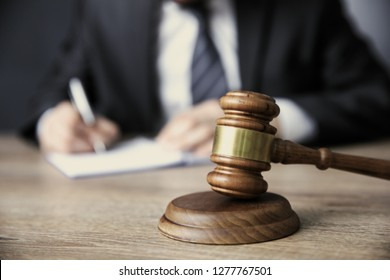man hand document with judge on table