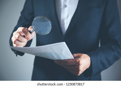 man hand document and magnifier