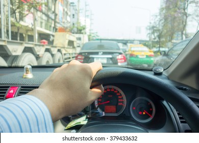 The Man hand driving car on the traffic jam