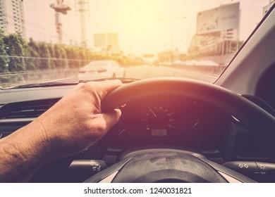 Man hand driving car. vintage filter