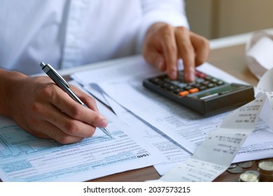 Man hand filling US tax form. tax form us business income office Financial document. Tax time.Tax concept. Close-up.