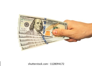 man hand giving 100 dollar bills isolated on white background. 500 dollars closeup. The guy keeps fingers five hundred American dollars