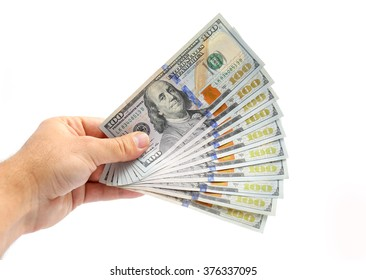 man hand giving 100 dollar bills isolated on white background