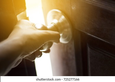 a man hand grab at door knob and opening the door to escape or to find the successful light