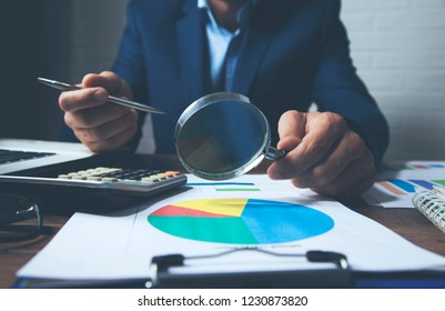 man hand graph and magnifier