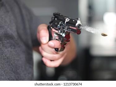 man with hand gun pistol rubber attack violence photomanipulation