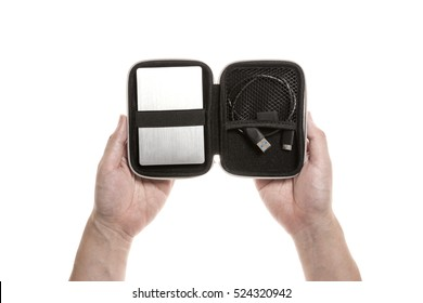 A man hand hold a aluminum portable hard disk(card), usb cable with case isolated white.