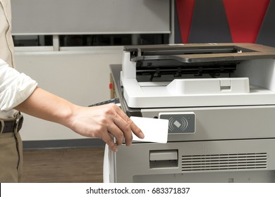 man hand hold card for scanning key card to access Photocopier . Security system concept
