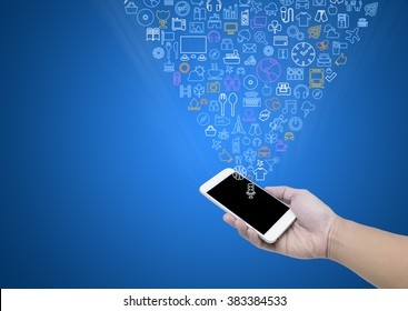 Man hand hold mobile phone and Media icons on blue background.