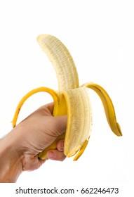 man hand holding banana isolated over white background