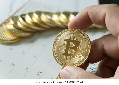 Man hand holding bitcoin and calendar background , cryptocurrency coins