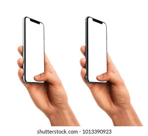 Man hand holding the black smartphone with blank screen and modern frame less design - isolated on white background
