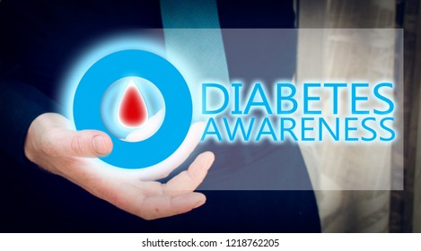 man hand holding blue glowing circle with blood drop, diabetes awarees concept