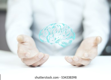 man hand holding  brain on white background