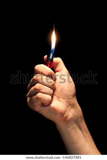 Man hand holding burning lighter