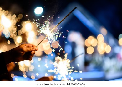 Man hand holding a burning sparkler. Bengal fire