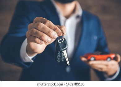 man  hand holding car with  key