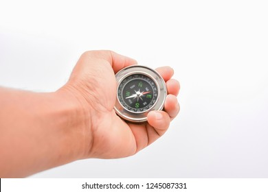 Man hand holding compass , isolated on white background.