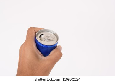 Man hand holding cool drink can on white background.