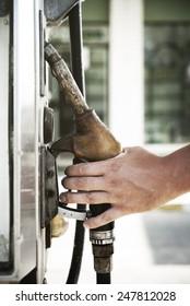 Man hand holding fuel pump