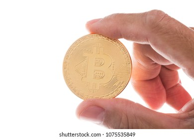 Man hand holding gold bitcion on white background