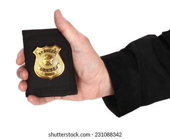Man hand is holding golden special officer badge