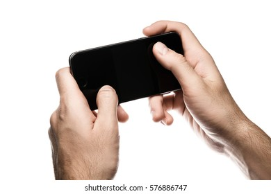 Man hand holding horizontal the black smartphone, isolated on white background.