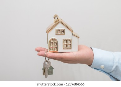 Man hand holding house model