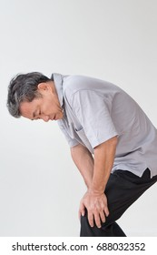 man hand holding knee joint pain, osteoporosis, gout, knee bone joint problem issue