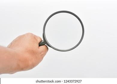 Man hand holding magnifying, isolated on white background