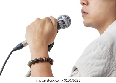 Man and hand holding Microphone stand sing song isolated on white background, closeup