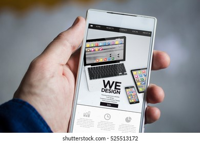 man hand holding mobile design website smartphone. All screen graphics are made up.