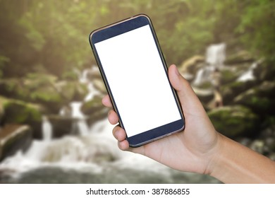 Man hand holding mobile smart phone , tablet,cellphone over Blur of water fall backgrond with.shopping online concept.vintage photo color,,can be used for montage or display your products