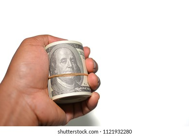 Man hand holding money (100 dollars banknote) over white background. copy space for text.
