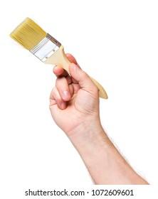 Man hand holding new paint brush isolated on white background