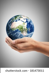 Man hand holding object ( Earth ) High resolution. including elements furnished by NASA