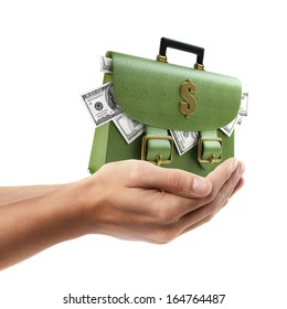 Man hand holding object ( Green leather briefcase with dollars )  isolated on white background. High resolution